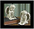 Pair of Reading Cherub Figurines