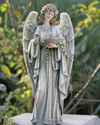 A sweet angel girl statue walks your way; suitable also for indoor use.