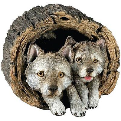 Gray Wolf Puppies In Log