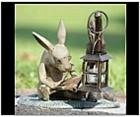 Smart Reading Rabbit and Candle Lantern Statue